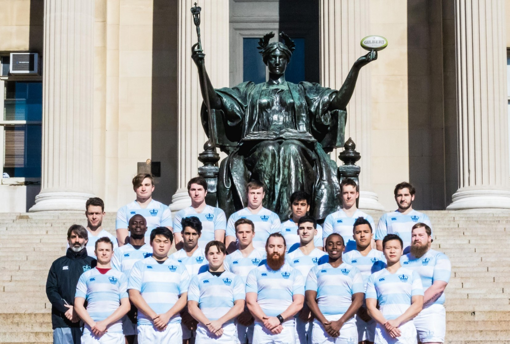 Columbia's Men's Rugby Team poses in front of Alma Mater.
